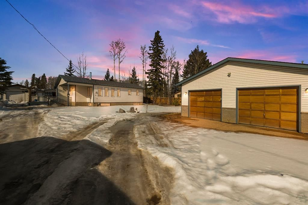 1,289 sqft home with oversized double garage and detached single garage located at beautiful Gregoire Lake Estates
