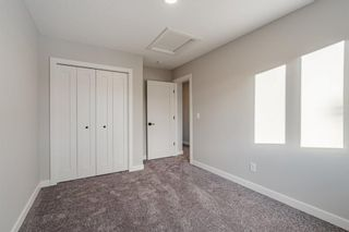 Photo 26: 309 81 Greenbriar Place NW in Calgary: Greenwood/Greenbriar Row/Townhouse for sale : MLS®# A1058995
