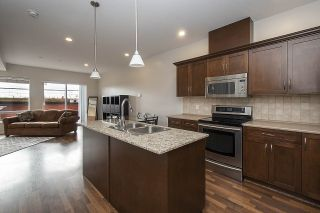 """Photo 2: #209 2655 MARY HILL Road in Port Coquitlam: Central Pt Coquitlam Condo for sale in """"Falcon Court"""" : MLS®# R2557522"""