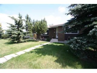 Photo 2: 7830 HUNTERVIEW Drive NW in CALGARY: Huntington Hills Residential Detached Single Family for sale (Calgary)  : MLS®# C3443193