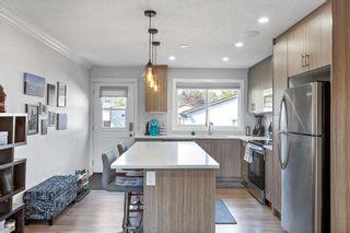 Photo 8: 6528/6528B 23 Avenue NE in Calgary: Pineridge Detached for sale : MLS®# A1033640