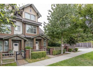 """Photo 1: 106 6655 192 Street in Surrey: Clayton Townhouse for sale in """"ONE 92"""" (Cloverdale)  : MLS®# R2492692"""