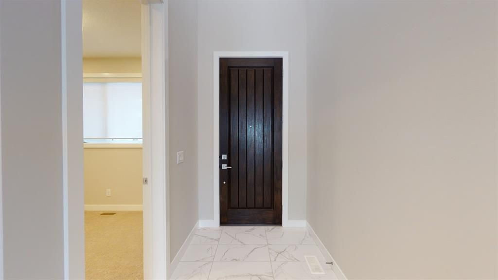 Photo 22: Photos: 38 Crestridge Bay SW in Calgary: Crestmont Row/Townhouse for sale : MLS®# A1073636