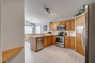 Photo 11: 60 Woodside Crescent NW: Airdrie Detached for sale : MLS®# A1110832