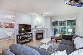 """Photo 1: 45 65 FOXWOOD Drive in Port Moody: Heritage Mountain Townhouse for sale in """"Forest Hill"""" : MLS®# R2384266"""