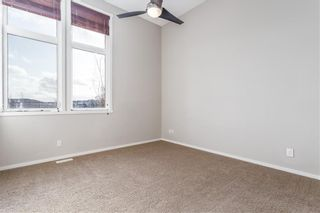 Photo 7: 204 WALDEN Drive SE in Calgary: Walden Row/Townhouse for sale : MLS®# C4274227