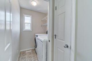 Photo 31: 4 136 Bow Ridge Drive: Cochrane Row/Townhouse for sale : MLS®# A1116097