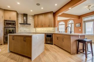 Photo 8: 39 Slopes Grove SW in Calgary: Springbank Hill Detached for sale : MLS®# A1110311