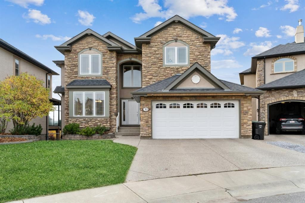 Main Photo: 30 Strathridge Park SW in Calgary: Strathcona Park Detached for sale : MLS®# A1151156