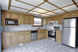 Photo 15: 1328 48 Avenue NW in Calgary: North Haven Detached for sale : MLS®# A1103760