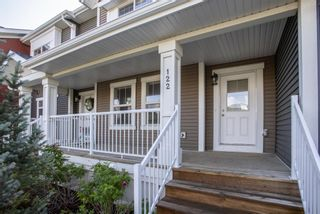Photo 2: 122 Sunset Road: Cochrane Row/Townhouse for sale : MLS®# A1127717