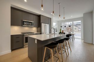 Photo 7: 60 19 Street NW in Calgary: West Hillhurst Semi Detached for sale : MLS®# A1120480