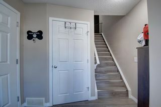 Photo 3: 149 WINDSTONE Avenue SW: Airdrie Row/Townhouse for sale : MLS®# A1033066