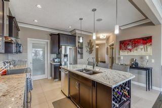Photo 4: 43 Sunset Way: Cochrane Detached for sale : MLS®# A1071186