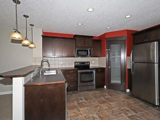 Photo 2: 223 EVANSTON Way NW in Calgary: Evanston House for sale : MLS®# C4178765