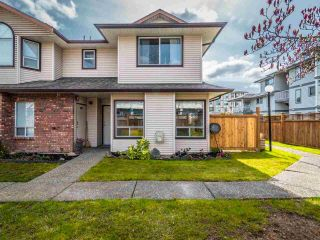 """Photo 1: 106 19908 56 Avenue in Langley: Langley City Townhouse for sale in """"CHENIER PLACE"""" : MLS®# R2561847"""