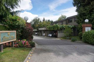 """Photo 1: 4097 PARKWAY Drive in Vancouver: Quilchena Townhouse for sale in """"ARBUTUS VILLAGE"""" (Vancouver West)  : MLS®# R2157602"""