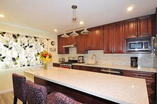 """Photo 2: 13 2980 MARINER Way in Coquitlam: Ranch Park Townhouse for sale in """"Mariner Mews"""" : MLS®# R2545748"""