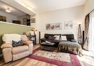 Photo 5: 19 Coachway Green SW in Calgary: Coach Hill Row/Townhouse for sale : MLS®# A1144999