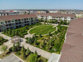 Photo 1: 2101 4 Kingsland Close SE: Airdrie Apartment for sale : MLS®# A1117201