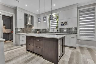"Photo 12: 6259 149 Street in Surrey: Sullivan Station House for sale in ""Sullivan Heights"" : MLS®# R2541457"