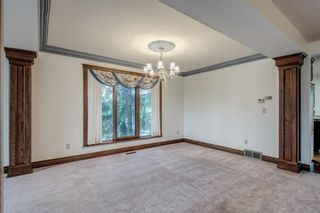 Photo 10: 331 Coach Light Bay SW in Calgary: Coach Hill Detached for sale : MLS®# A1132031