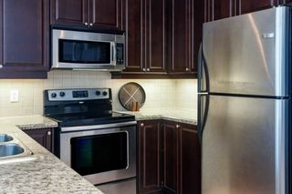 Photo 8: 410 33 Ellen Street in Barrie: City Centre Condo for sale : MLS®# S5302188