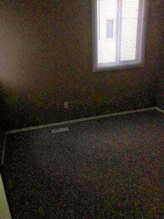 Photo 11: 125 LANCASTER Terrace in Edmonton: Zone 27 Townhouse for sale : MLS®# E4254544