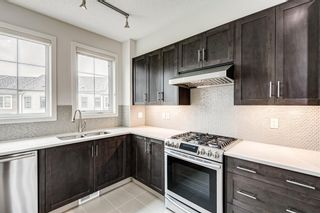 Photo 3: 30 Sherwood Row NW in Calgary: Sherwood Row/Townhouse for sale : MLS®# A1136563
