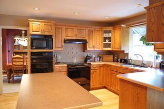 "Photo 8: 59 FOXWOOD Drive in Port Moody: Heritage Mountain House for sale in ""HERITAGE MOUNTAIN"" : MLS®# V1073411"