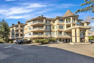 "Main Photo: 310 20120 56 Avenue in Langley: Langley City Condo for sale in ""Blackberry Lane"" : MLS®# R2564037"