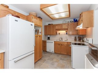 """Photo 7: 102 5375 205 Street in Langley: Langley City Condo for sale in """"GLENMONT PARK"""" : MLS®# R2053882"""