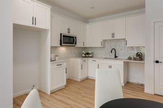 Photo 16: 249 Lucas Avenue NW in Calgary: Livingston Row/Townhouse for sale : MLS®# A1102463