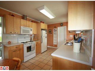 Photo 7: 12572 CENTRE Drive in Surrey: Cedar Hills House for sale (North Surrey)  : MLS®# F1113518