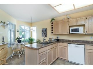 """Photo 3: 13 19649 53 Avenue in Langley: Langley City Townhouse for sale in """"Huntsfield Green"""" : MLS®# R2412498"""