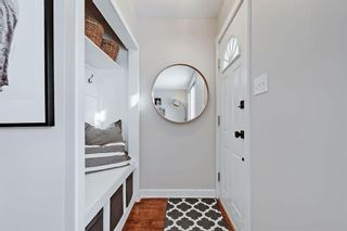 Photo 2: 710 53 Avenue SW in Calgary: Windsor Park Semi Detached for sale : MLS®# A1067398