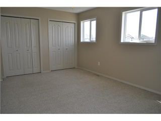 Photo 8: 159 BAYSIDE Point SW: Airdrie Townhouse for sale : MLS®# C3566247