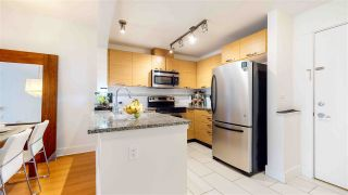 """Photo 1: 313 7418 BYRNEPARK Walk in Burnaby: South Slope Condo for sale in """"GREEN"""" (Burnaby South)  : MLS®# R2501039"""