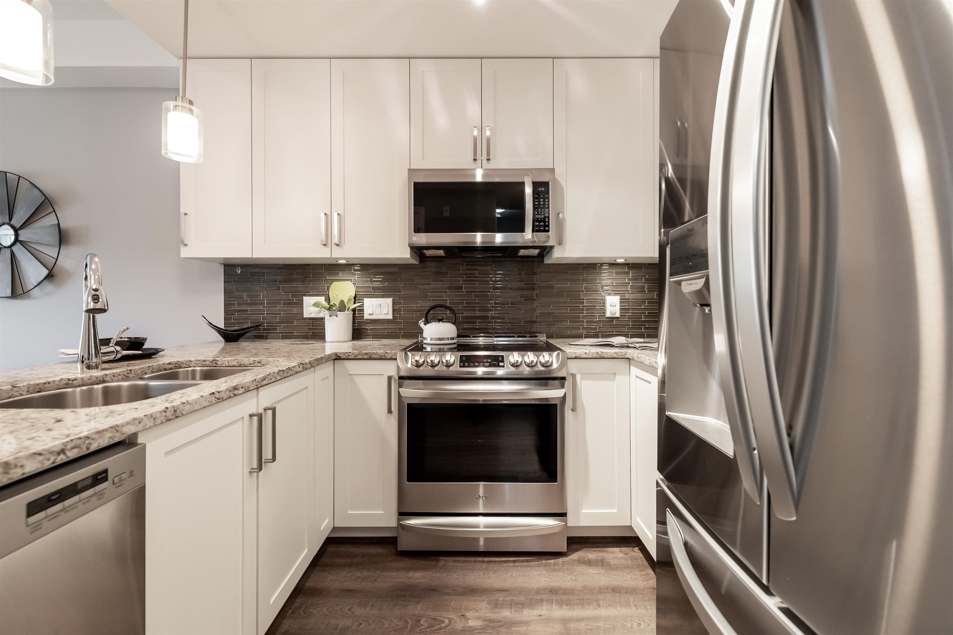 """Main Photo: 308 6470 194 Street in Surrey: Clayton Condo for sale in """"Waterstone"""" (Cloverdale)  : MLS®# R2622977"""
