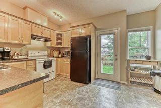 Photo 12: 511 Strathaven Mews: Strathmore Row/Townhouse for sale : MLS®# A1118719