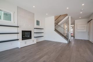 Photo 15: 154 69 Street SW in Calgary: Strathcona Park Residential for sale : MLS®# A1054727