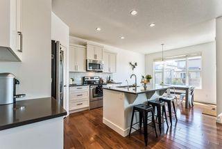 Photo 5: 28 Auburn Glen View SE in Calgary: Auburn Bay Detached for sale : MLS®# A1095232