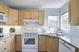 Photo 4: 33 200 Hidden Hills Terrace NW in Calgary: Hidden Valley Row/Townhouse for sale : MLS®# A1141008
