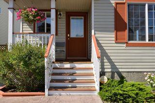 Photo 2: 41 BRIDLERIDGE Gardens SW in Calgary: Bridlewood House for sale : MLS®# C4135340