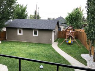 Photo 6: 2031 52 Avenue SW in Calgary: North Glenmore Park Detached for sale : MLS®# A1059510