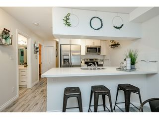 """Photo 13: 306 5650 201A Street in Langley: Langley City Condo for sale in """"Paddington Station"""" : MLS®# R2545910"""