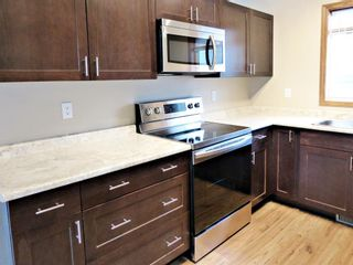 Photo 7: 107 Mt Allan Circle SE in Calgary: McKenzie Lake Detached for sale : MLS®# A1068557