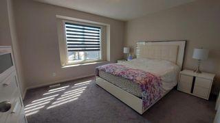 Photo 14: 110 Auburn Meadows Avenue SE in Calgary: Auburn Bay Semi Detached for sale : MLS®# A1095114