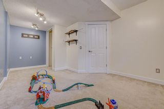 Photo 22: 34 Rockbluff Close NW in Calgary: Rocky Ridge Detached for sale : MLS®# A1123791