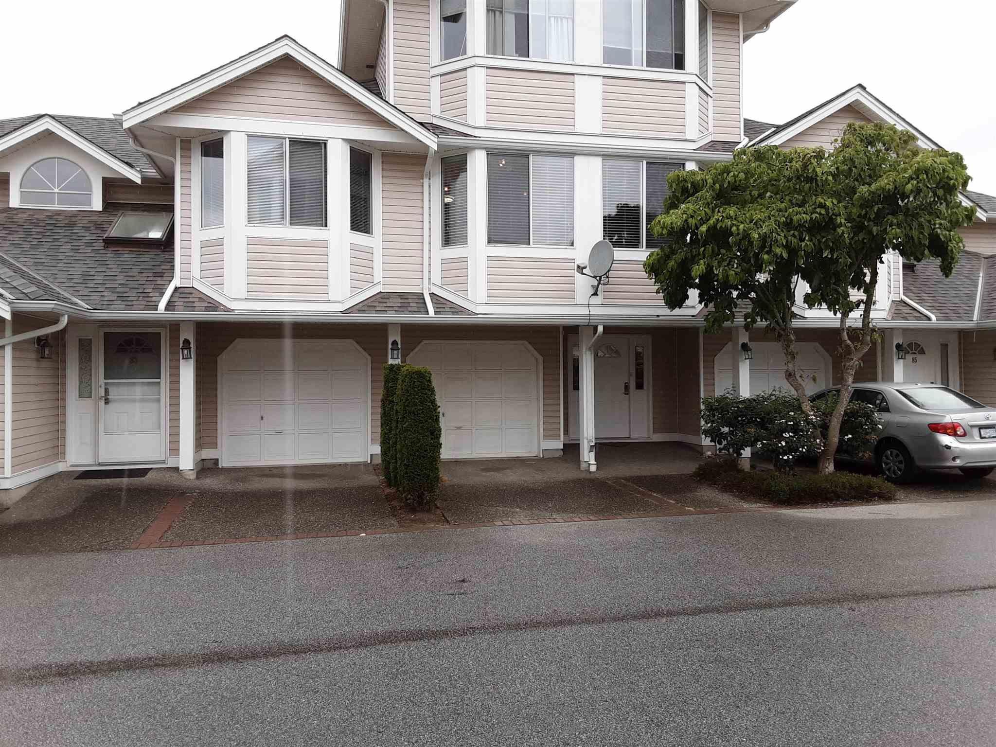 "Main Photo: 84 7955 122 Street in Surrey: West Newton Townhouse for sale in ""Scottsdale Village"" : MLS®# R2602527"